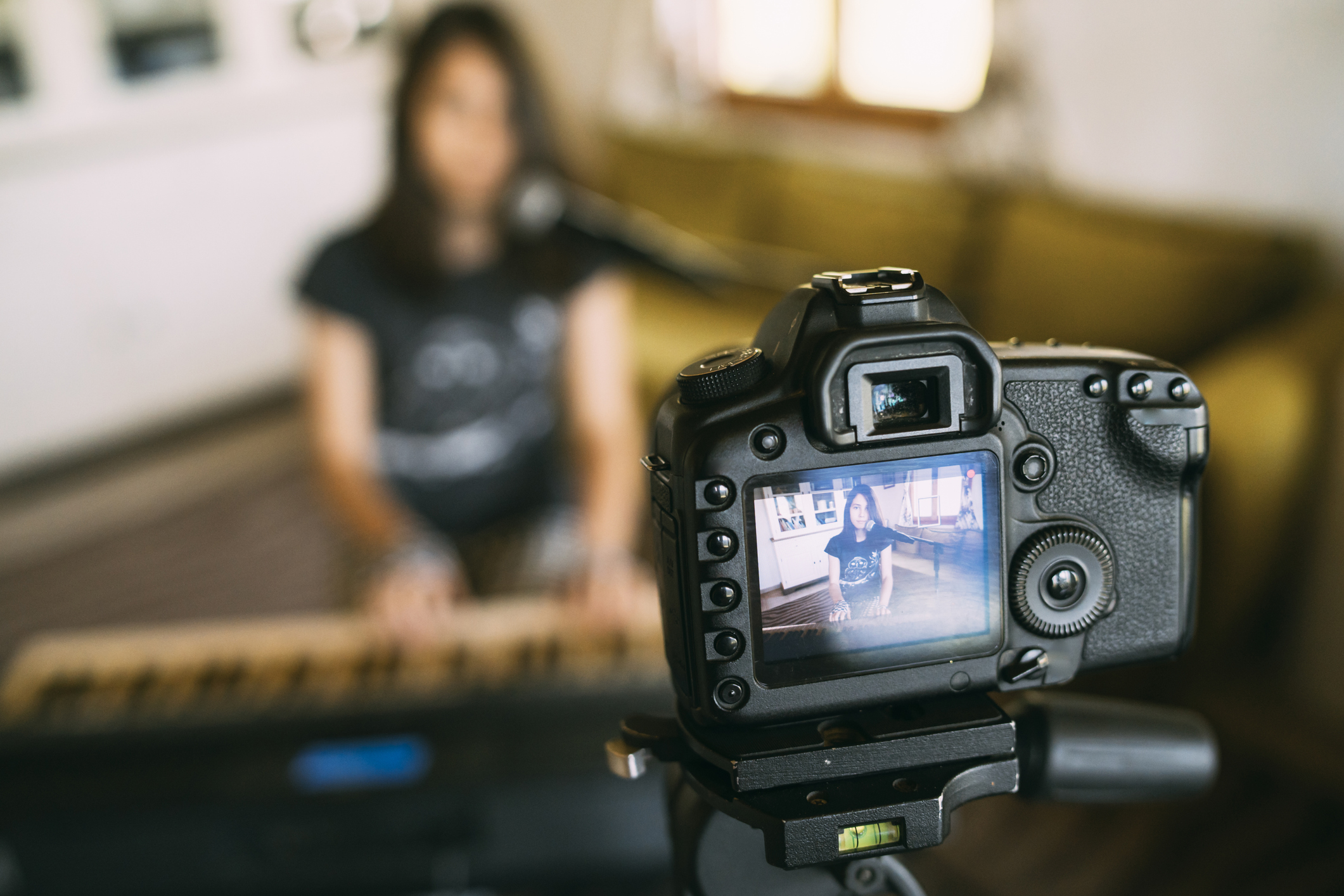 Video call recording of a teenage girl playing the piano
